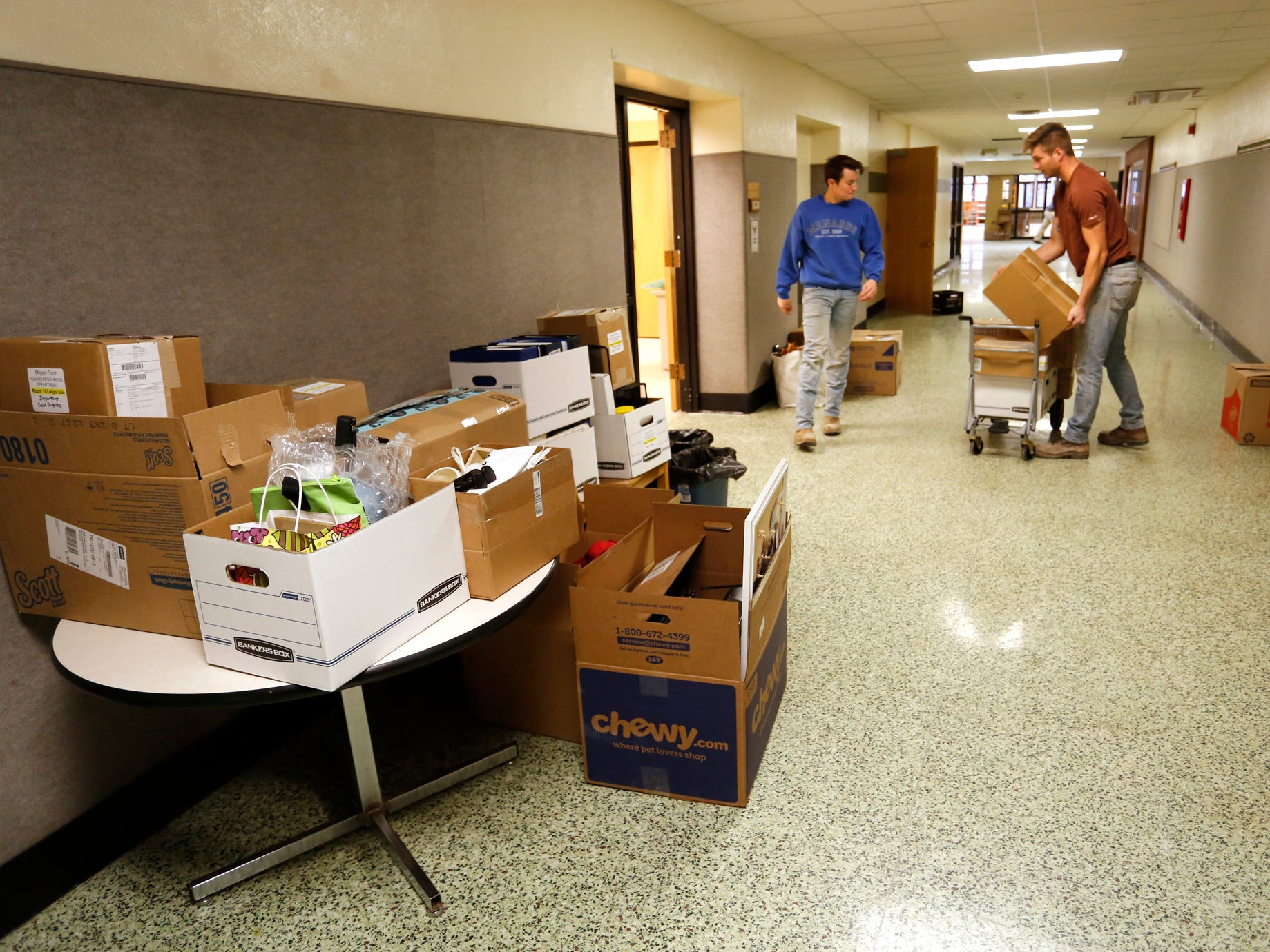 John Spencer, left, and Jarrod Patzschke help as the City of West Lafayette moves its offices from the Morton Center into Happy Hollow School Monday, December 17, 2018, in West Lafayette. The city will keep it's offices in Happy Hollow for two years while the Morton Center is being renovated. The city will move its offices back to the Morton Center when renovations are completed.