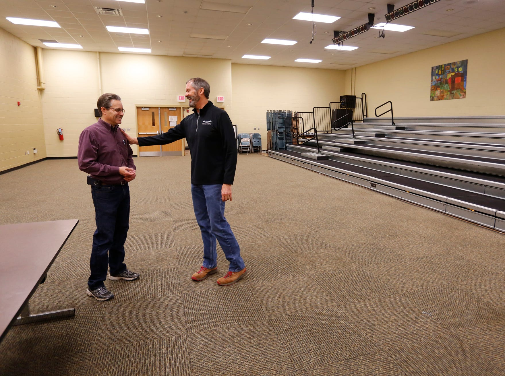 West Lafayette Mayor John Dennis and City Controller Peter Gray share a laugh in the large group instruction room (LGI) inside the former Happy Hollow School Monday, December 17, 2018, in West Lafayette. The city is moving it's offices into Happy Hollow for two years while the Morton Center is being renovated. The city will move its offices back to the Morton Center when renovations are completed.