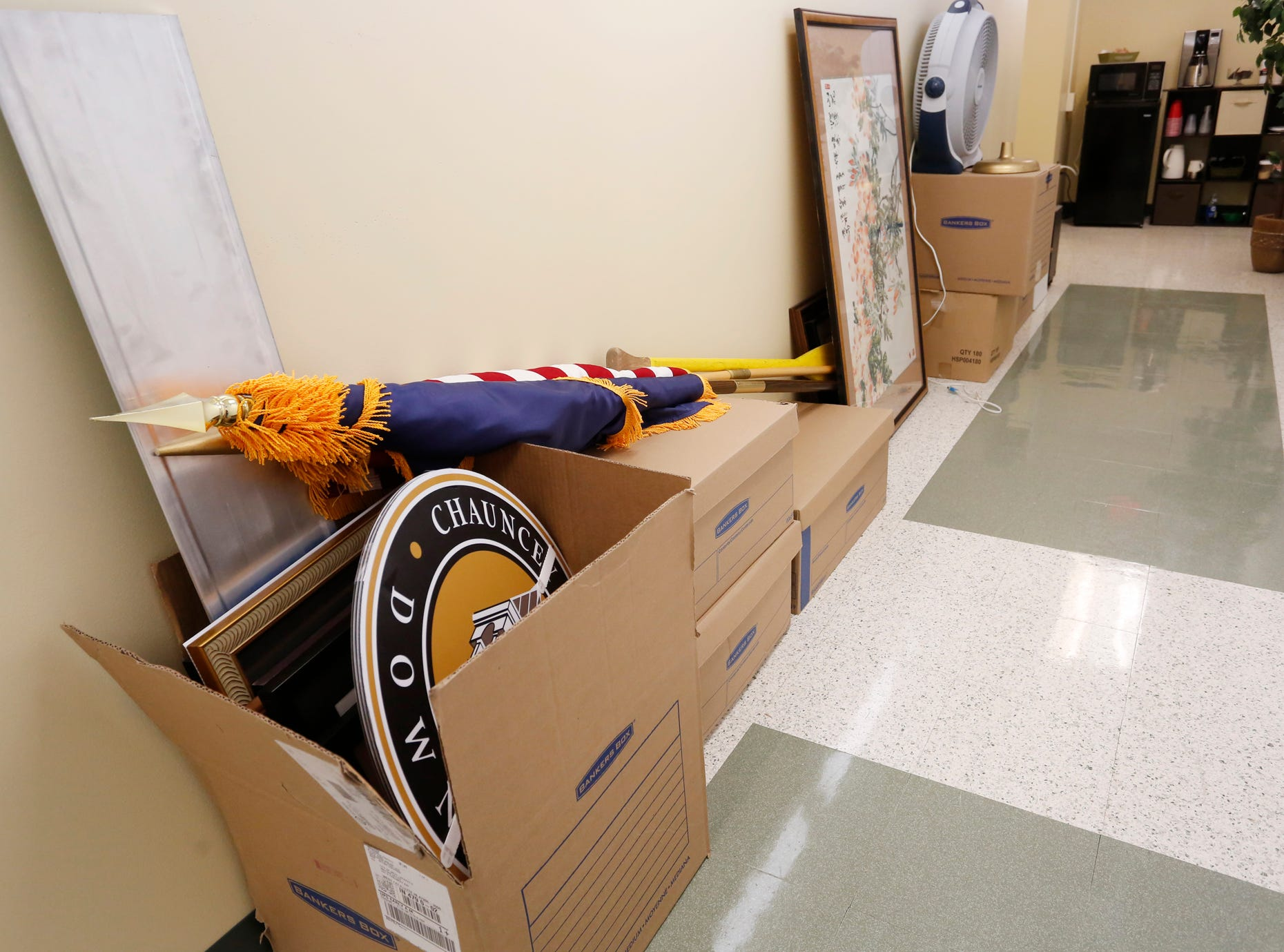 Several items remain in boxes in the hall just outside Mayor John Dennis' office as the City of West Lafayette moves its offices from the Morton Center into the former Happy Hollow School Monday, December 17, 2018, in West Lafayette. The city will keep it's offices in Happy Hollow for two years while the Morton Center is being renovated. The city will move its offices back to the Morton Center when renovations are completed.