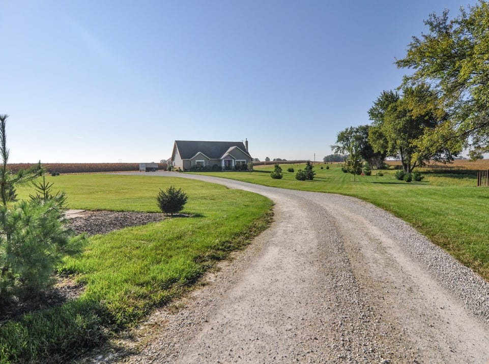 Surrounded by farming fields, this rural Carroll County home offers seclusion just outside of Rossville within a short drive of Lafayette.