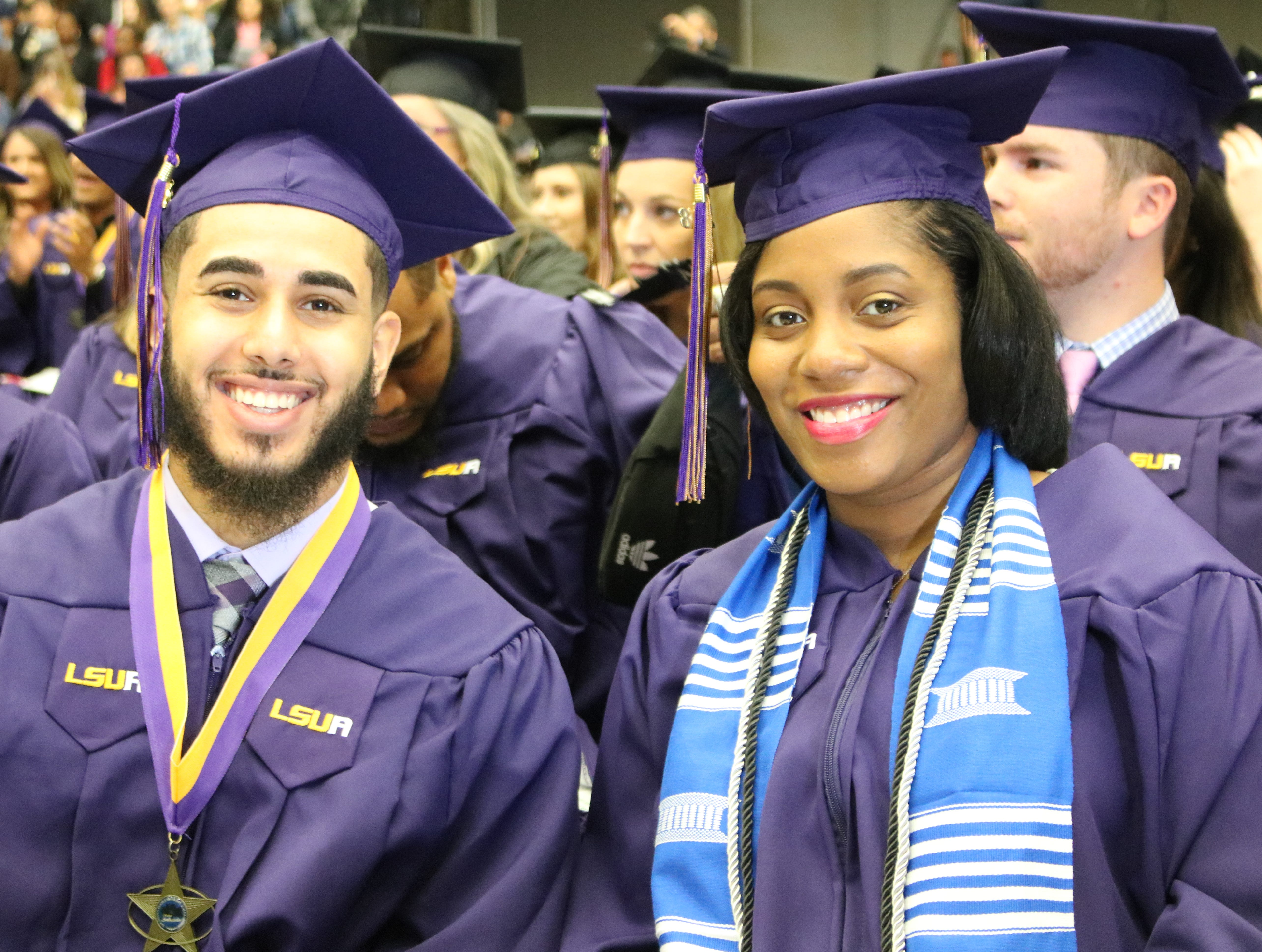 Yousef Ijbara and Anshonarial Greenhouse smile before crossing the stage to receive their degrees Dec. 13, 2018, at the University of Louisiana of Alexandria's winter graduation. Greenhouse was in labor during the ceremony but waited to go to the hospital until her diploma was in hand.