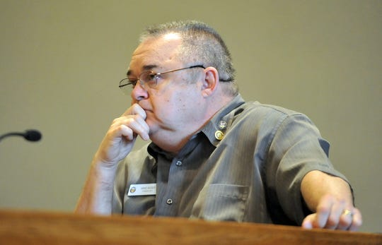 Fairfield County Commissioner Mike Kiger listens to statements made by opponents to the Pearl House's proposed location in downtown Lancaster during a hearing Tuesday, Nov. 15, 2011.