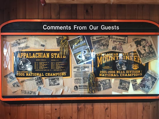 A case in the lobby of Appalachian Ski Mountain holds memories from Appalachian State's three straight national championships. Scott Satterfield was the play caller for all three teams.