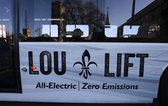 The Lou Lift TARC circulator stops to charge near 3rd and York.  Dec. 17, 2018