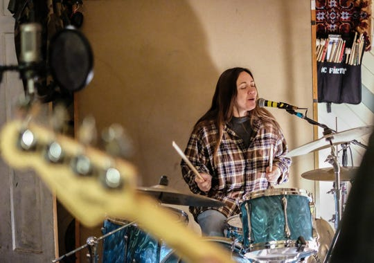 Hattie Danby plays drums and sings at rehearsal in the recording space Sunday, Dec. 16, 2018.