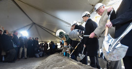 Officials and board members from McLaren, Michigan State University, and the City of Lansing, pictured Monday, Dec. 17, 2018, at the groundbreaking for McLaren's new hospital.