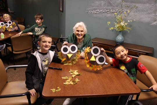 Jefferson Elementary students visited Felician Village, talking and working on crafts with assigned 'buddies,' raising the spirits of all involved.