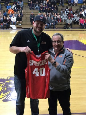 Mansfield News Journal sports reporter Jake Furr presents fellow sports reporter Jon Spencer a News Journal All-Star Classic jersey celebrating his 40th all-star game. On Friday, Spencer celebrated his 40th year with the Mansfield News Joural.