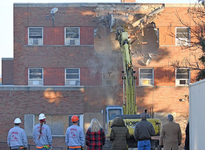 The demolition of the exterior of the former YMCA building on Park Avenue West started Monday morning on the south side of the building.