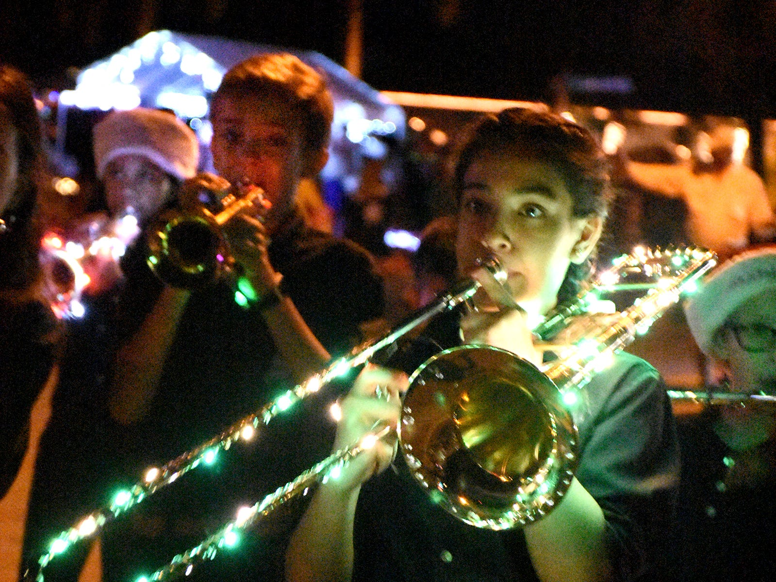 The MICMS band is lit up like a Christmas tree during Saturday night's Christmas parade.