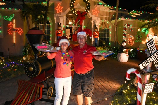 Judges drop off a finalist's certificate, and return with cookies.The winners of the annual Christmas Home Decorating Contest were honored Friday night in Marco Island.