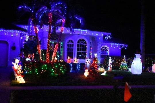 The yard, the trees, the shrubs and the house are all lit up at this finalist. The winners of the annual Christmas Home Decorating Contest were honored Friday night.