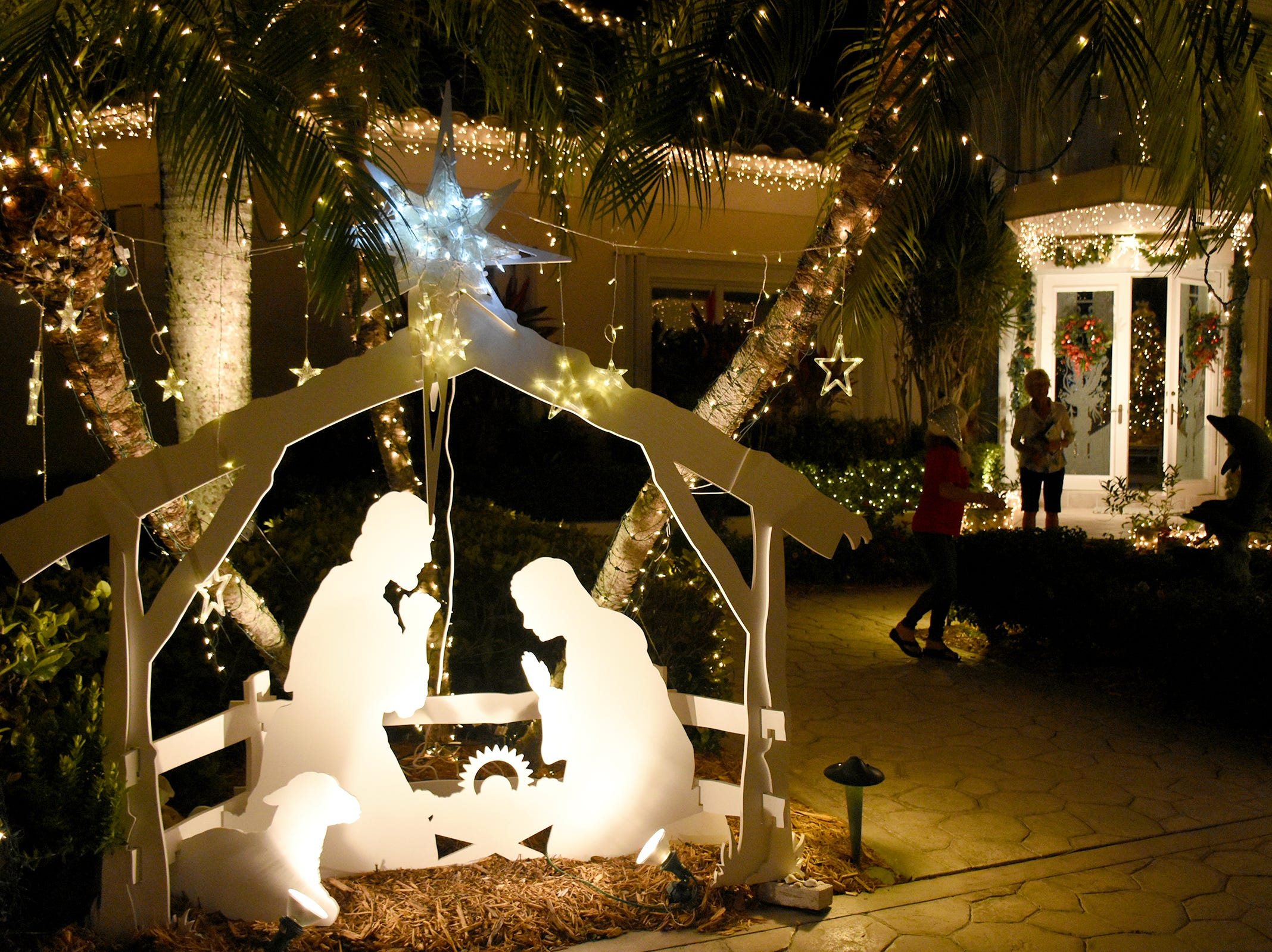"A classic ""white Christmas"" look at 780 W. Copeland Dr. The winners of the annual Christmas Home Decorating Contest were honored Friday night, as the judges made the rounds of the finalists and picked an overall winner."