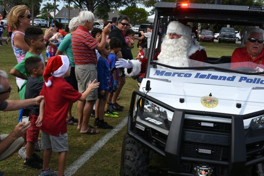 After Santa's chopper touched down, he and Mrs. Claus traveled courtesy of the MIPD, greeting the kids. Hundreds of children and parents showed up for cookies and milk with Santa at Mackle Park Saturday morning.