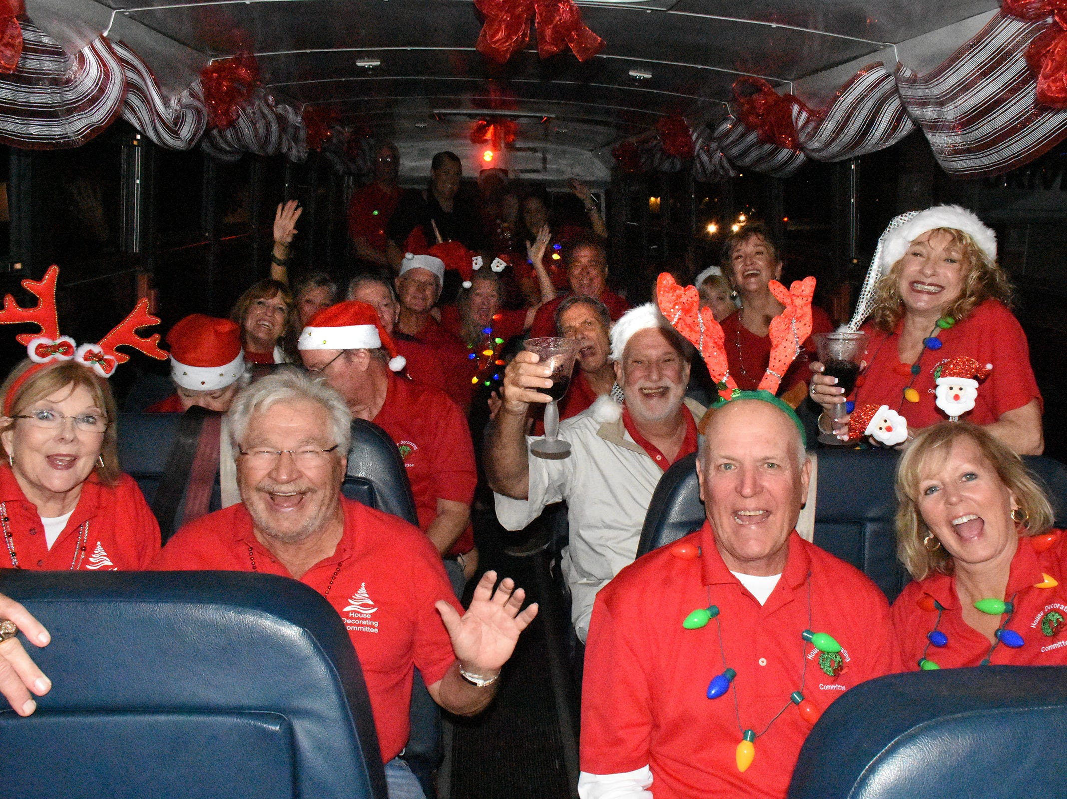 The judges set out on the bus. The winners of the annual Christmas Home Decorating Contest were honored Friday night, as the judges made the rounds of the finalists and picked an overall winner.