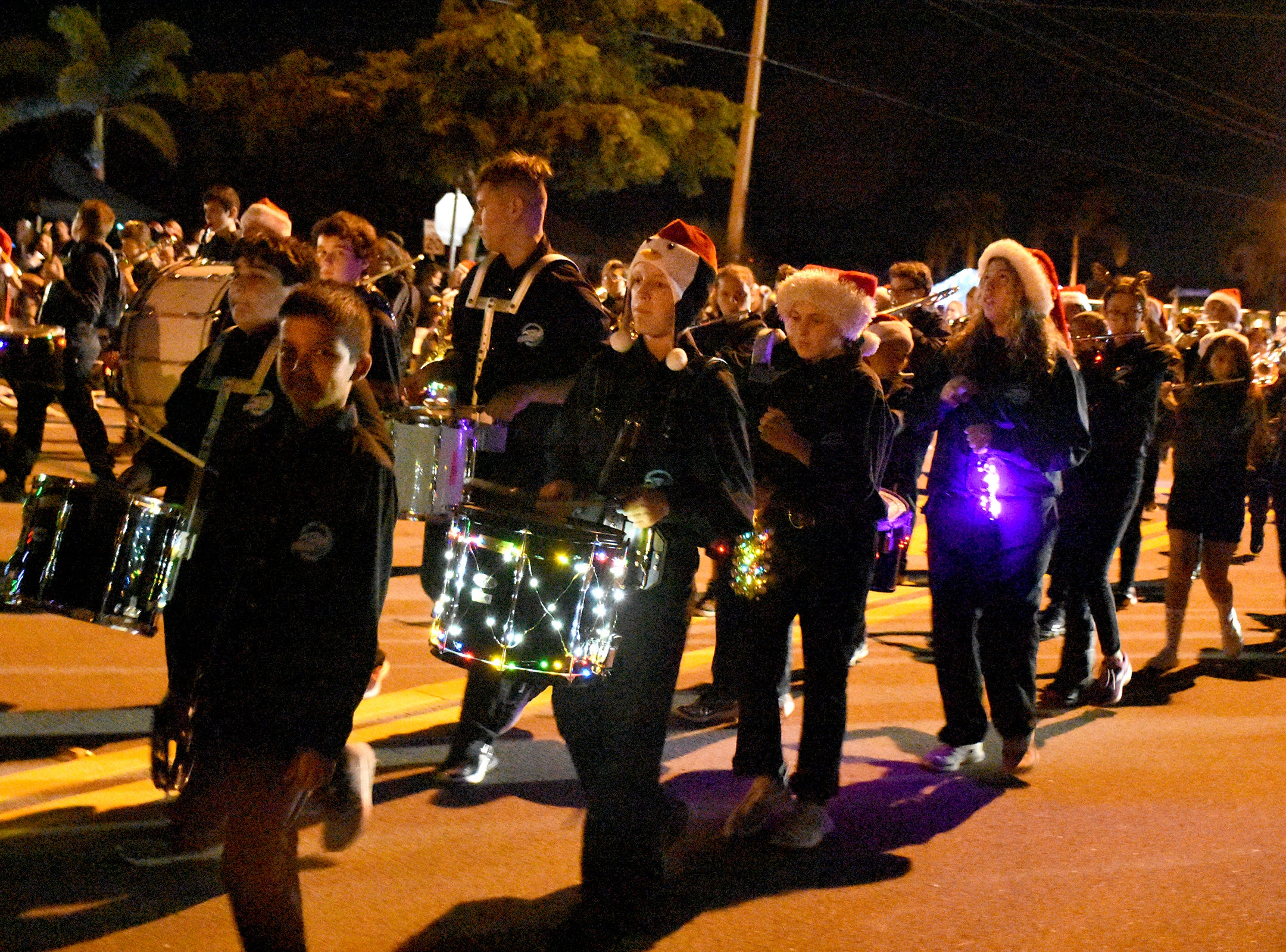 The MICMS band is lit up like a Christmas tree. Marco's Christmas Island Style street parade marched down San Marco Road on Saturday night, to the delight of a throng of spectators.