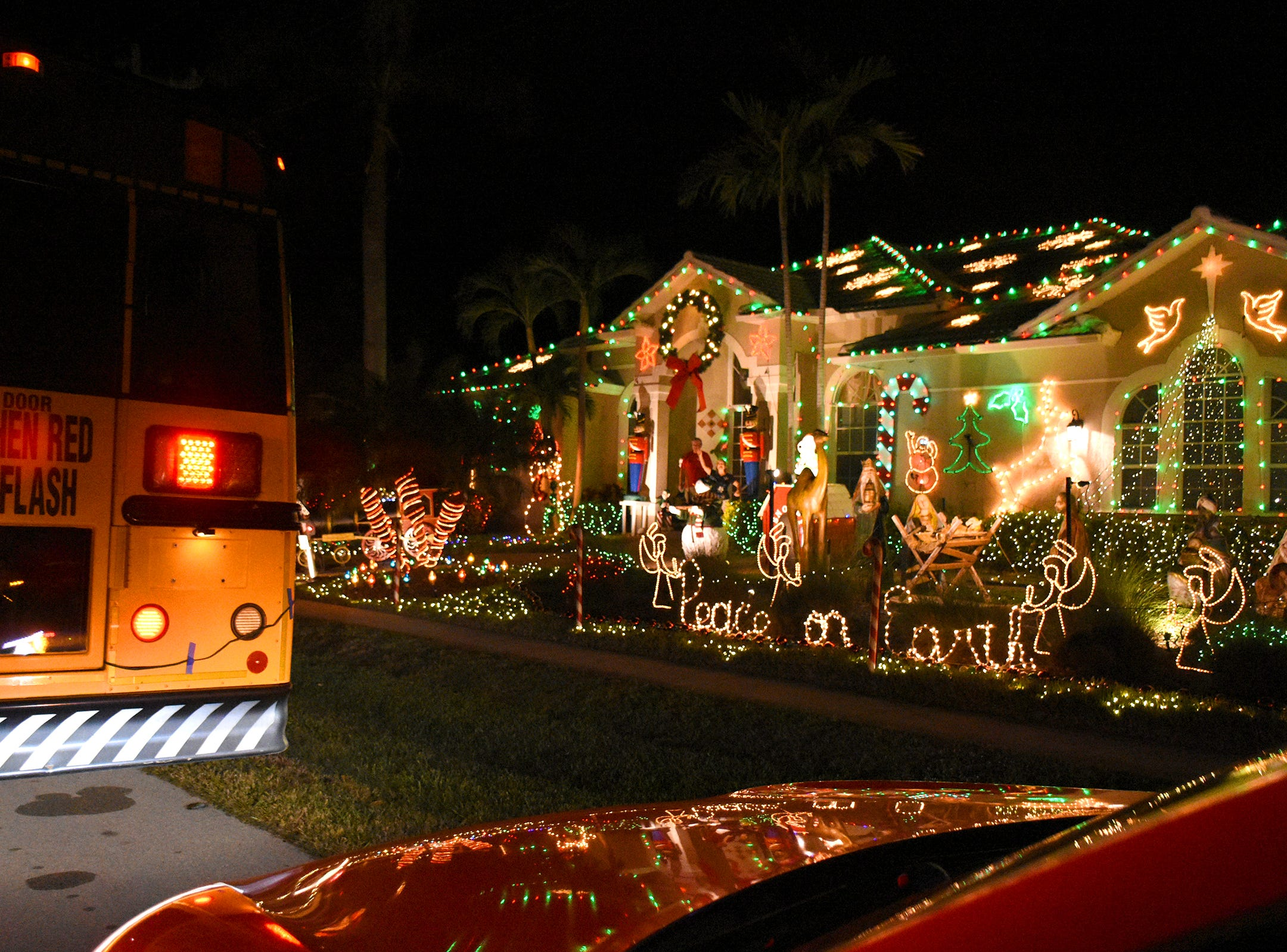 The judges' bus stops at a finalist on Friday during the judging of the annual Christmas Home Decorating Contest.