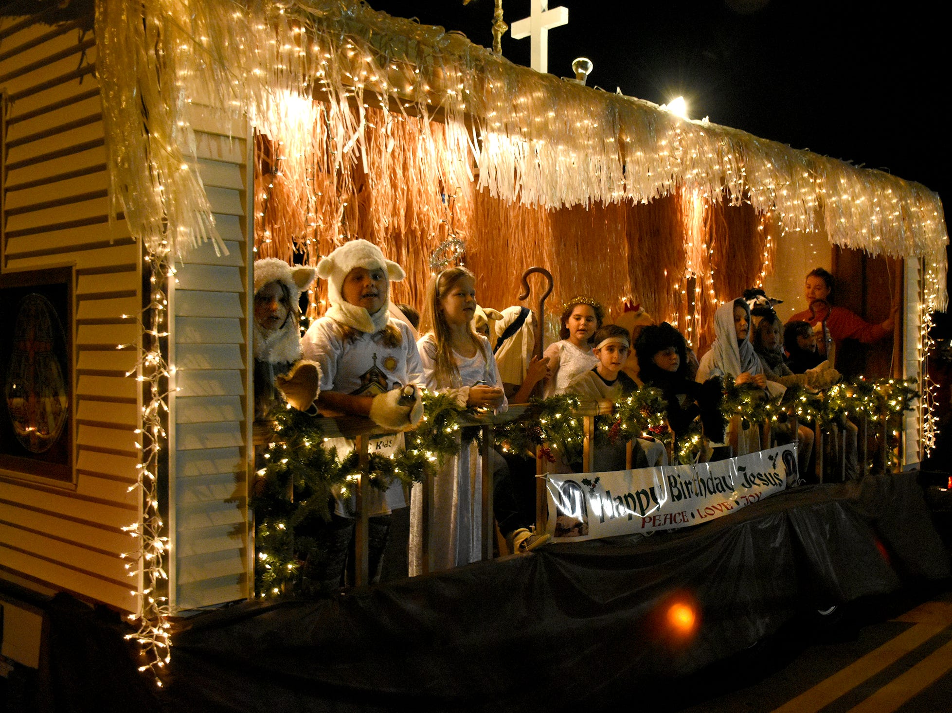 Marco Presbyterian Church shows a manger scene Saturday night during Marco's Christmas Island Style street parade.