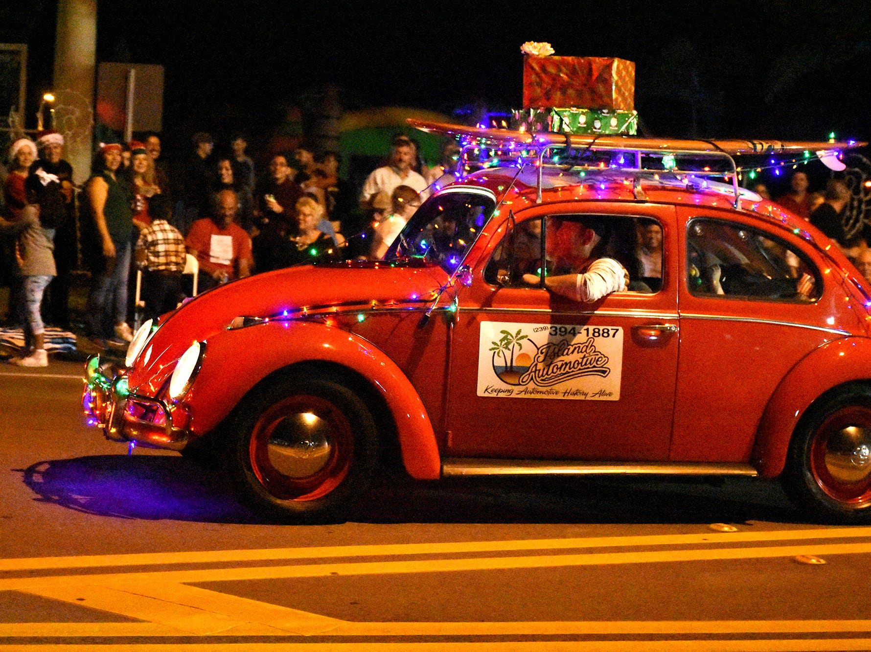Island Automotive's entries included this colorful bug. Marco's Christmas Island Style street parade marched down San Marco Road on Saturday night, to the delight of spectators.