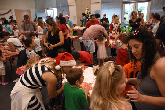 Crafts and cookies made for a whirlwind of activity during Santa's visit to Mackle Park on Saturday morning.