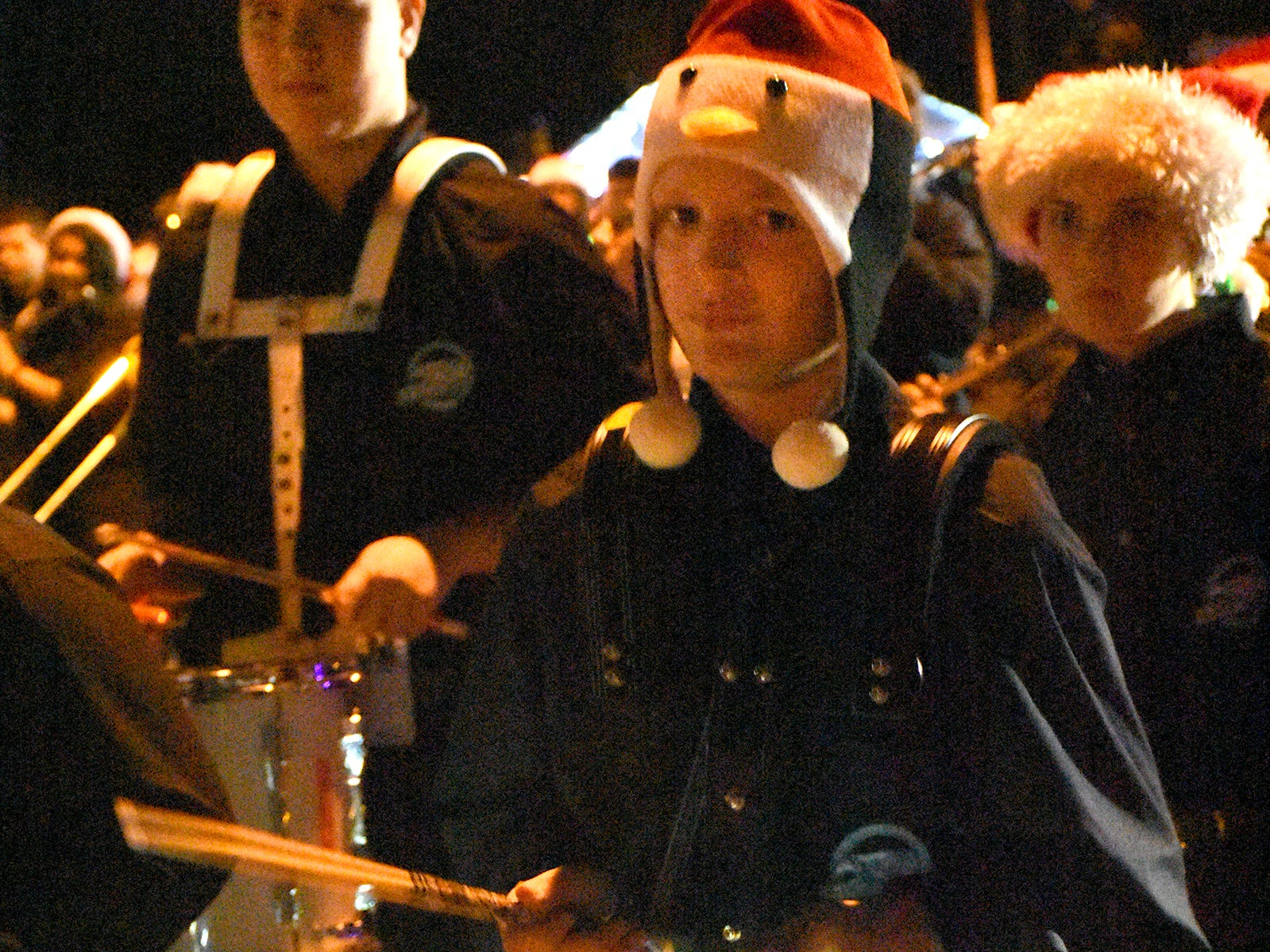 The MICMS band is lit up like a Christmas tree Saturday during Marco's Christmas Island Style street parade.