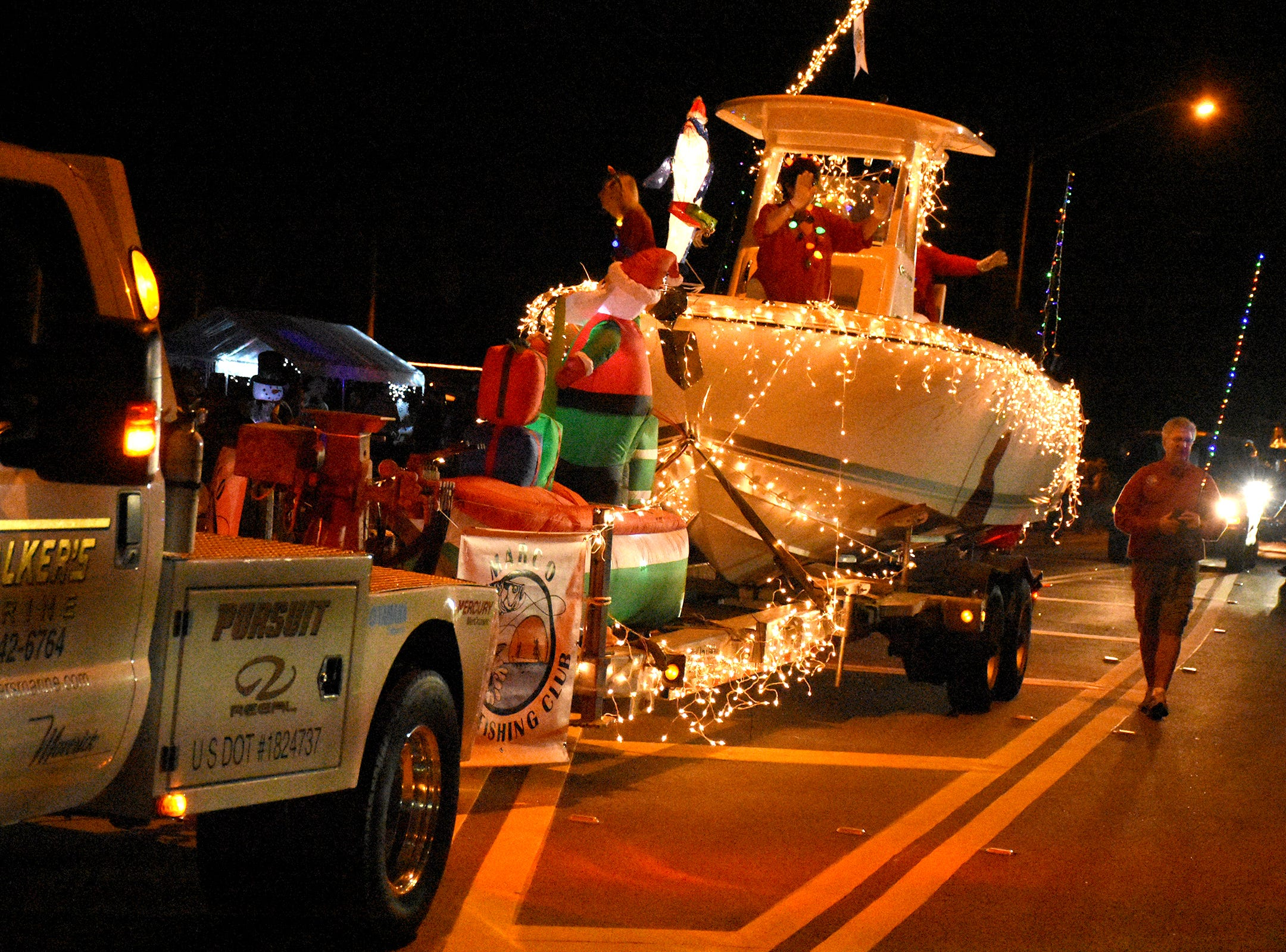 "Walker's Marine with a ""float"" in Marco Island's Christmas Island Style street parade Saturday night."