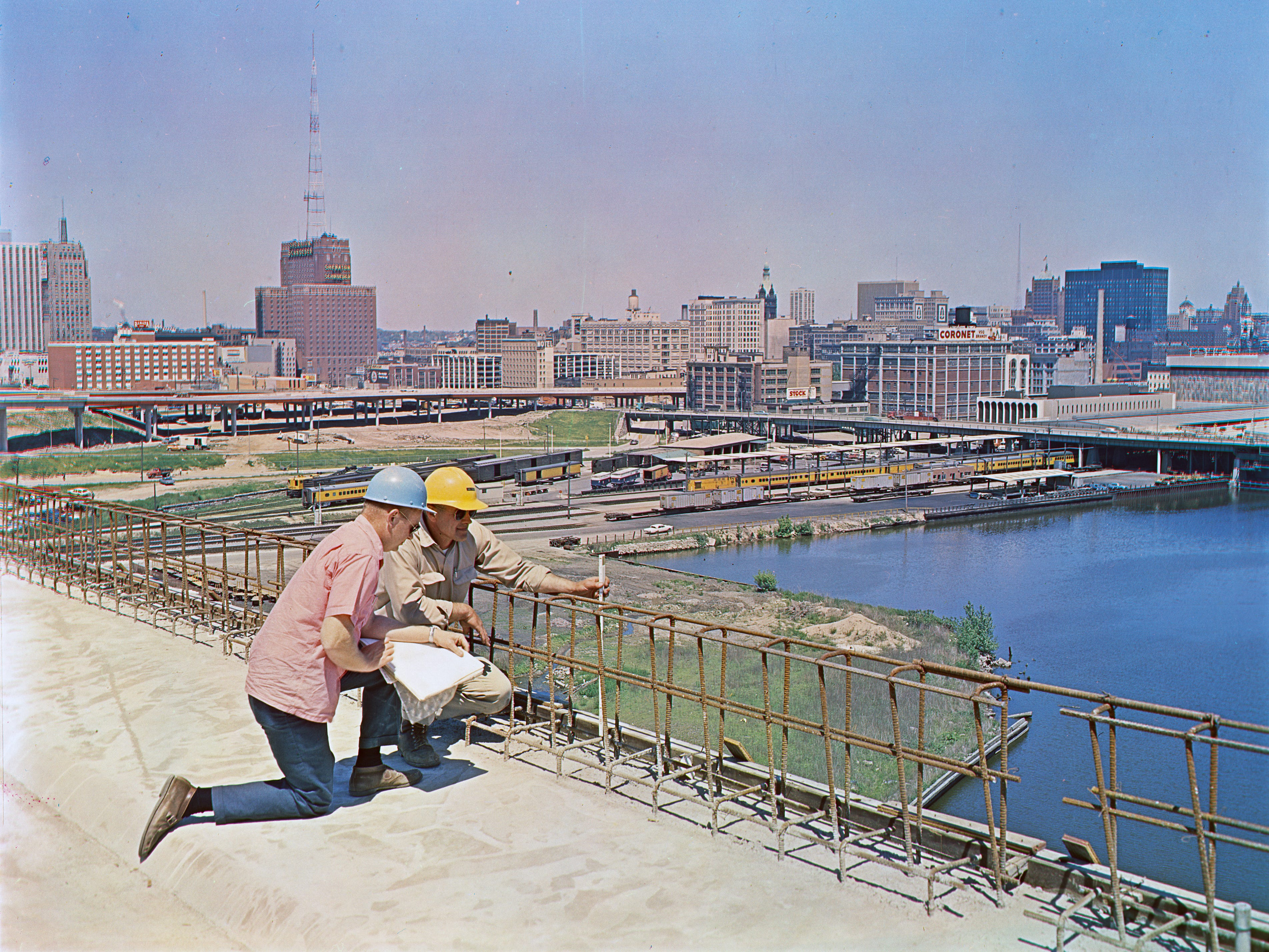 Two engineers on the North-South Freeway project check reinforcing rods on the bridge above the Menomonee River valley, running into the Marquette Interchange, during construction of the heart of the Milwaukee freeway system during the summer of 1968. The Marquette Interchange was opened to traffic on Dec. 23, 1968, linking the north and south sides of the city. This color-separated photo was published in the June 17, 1968, Milwaukee Journal.