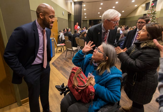 "Incoming Lt. Gov. Mandela Barnes (left) speaks with GinaMarie Opalscent while Gov.-elect Tony Evers  (center) speaks with another woman Dec. 11 at UW-Green Bay in Green Bay. The gathering was the first day of Evers and Barnes' statewide"" Building the People's Budget tour."""
