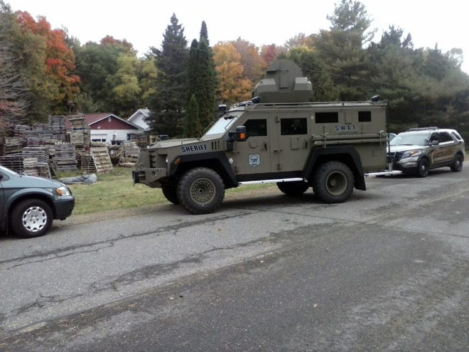 Marathon County sent this armored vehicle along with two dozen officers to collect a civil judgment from Roger Hoeppner in 2014. He recently settled a civil rights lawsuit over the incident.