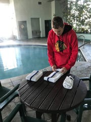 Andy Rudawski folds towels at Wildwood Hotel in Pewaukee, where he works in the maintenance department.
