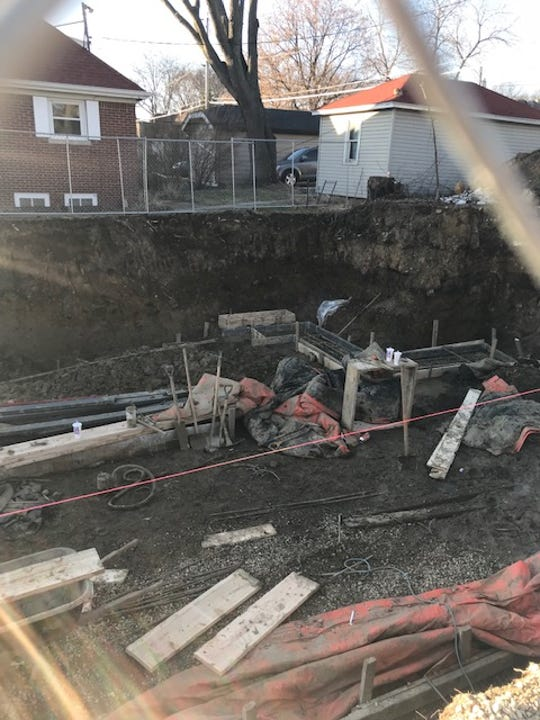 A hole is dug up to prepare for the log cabin to be placed on a GCA vacant lot and even allow for a landscaped, pocket park along its North Avenue frontage.