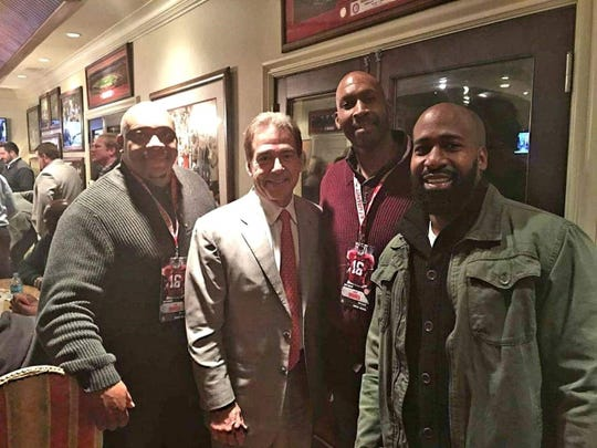 "Todd Dowell, Alabama coach Nick Saban, Chris Varner and Tracy ""Tyrome"" Varner"