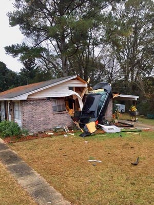 A car ended its journey inside a home on Perry Hill Road.