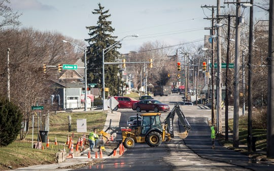 Construction crews work on paving West Jackson Street on Monday between West White River Road and Tillotson Avenue.