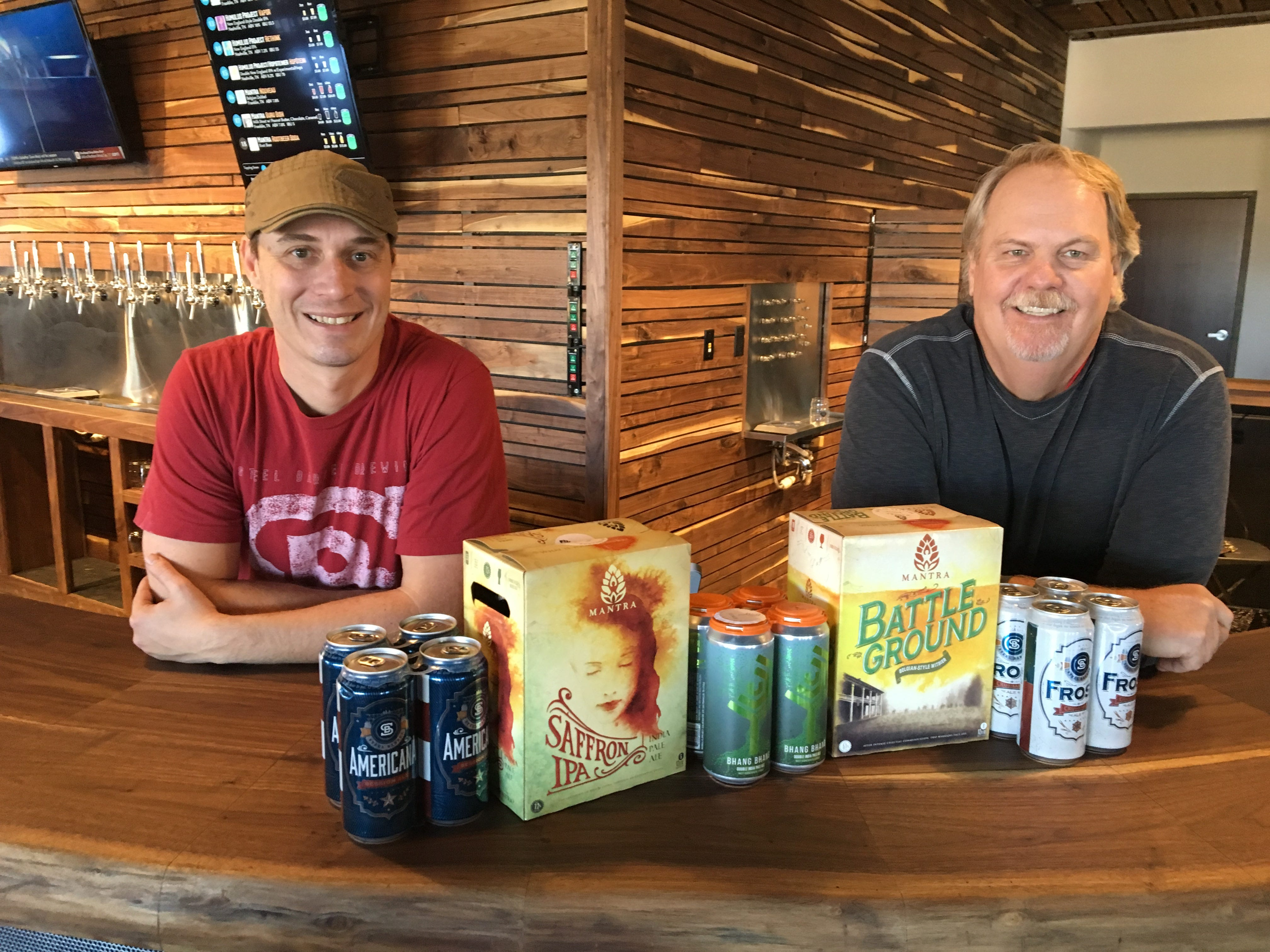 Steel Barrel brewmaster Derrick Morse, left, and CEO Mark Jones stand at the bar at Hop Springs Taproom.