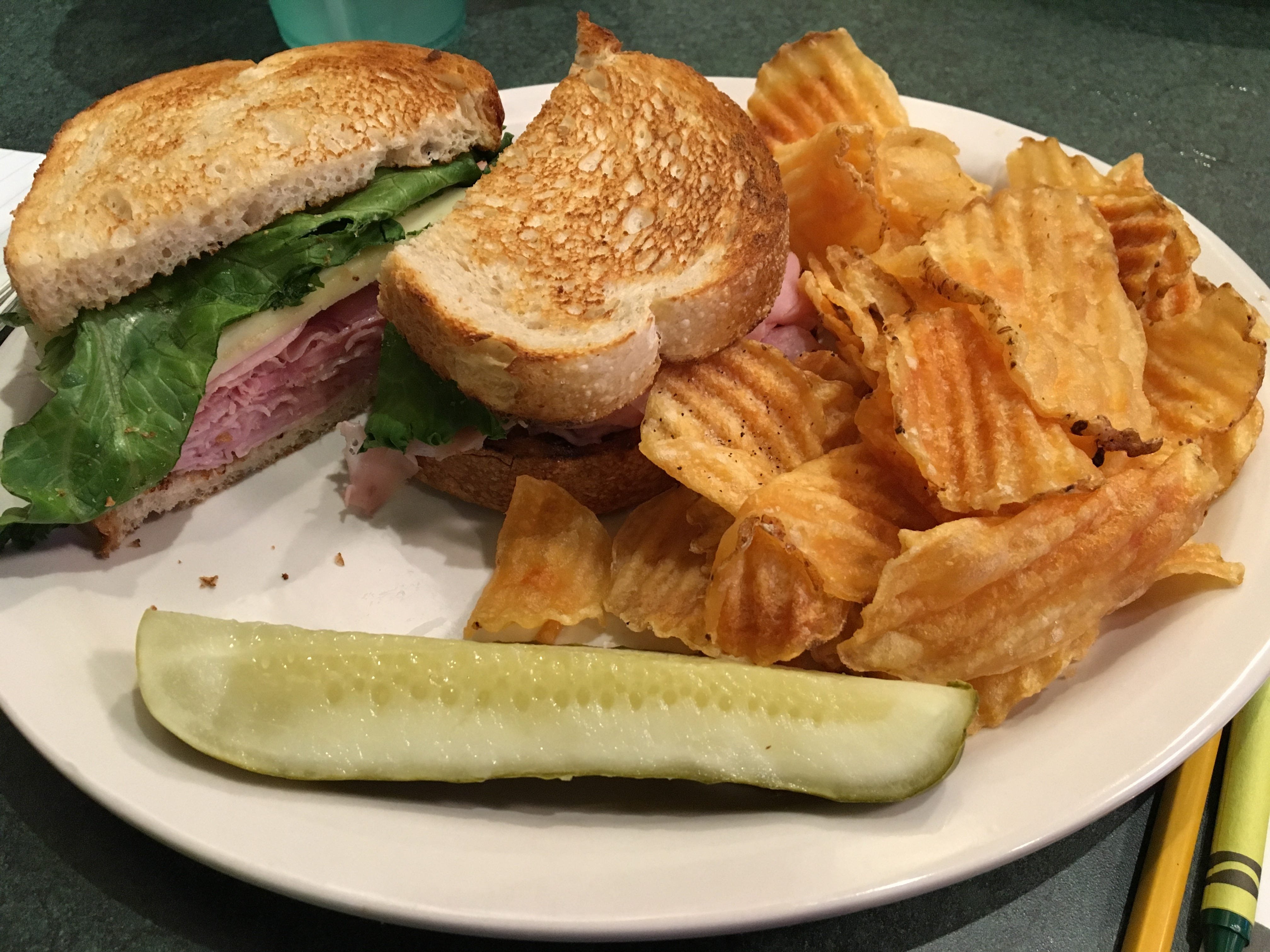 Kid-friendly ham and cheese sandwich with house-made potato chips.