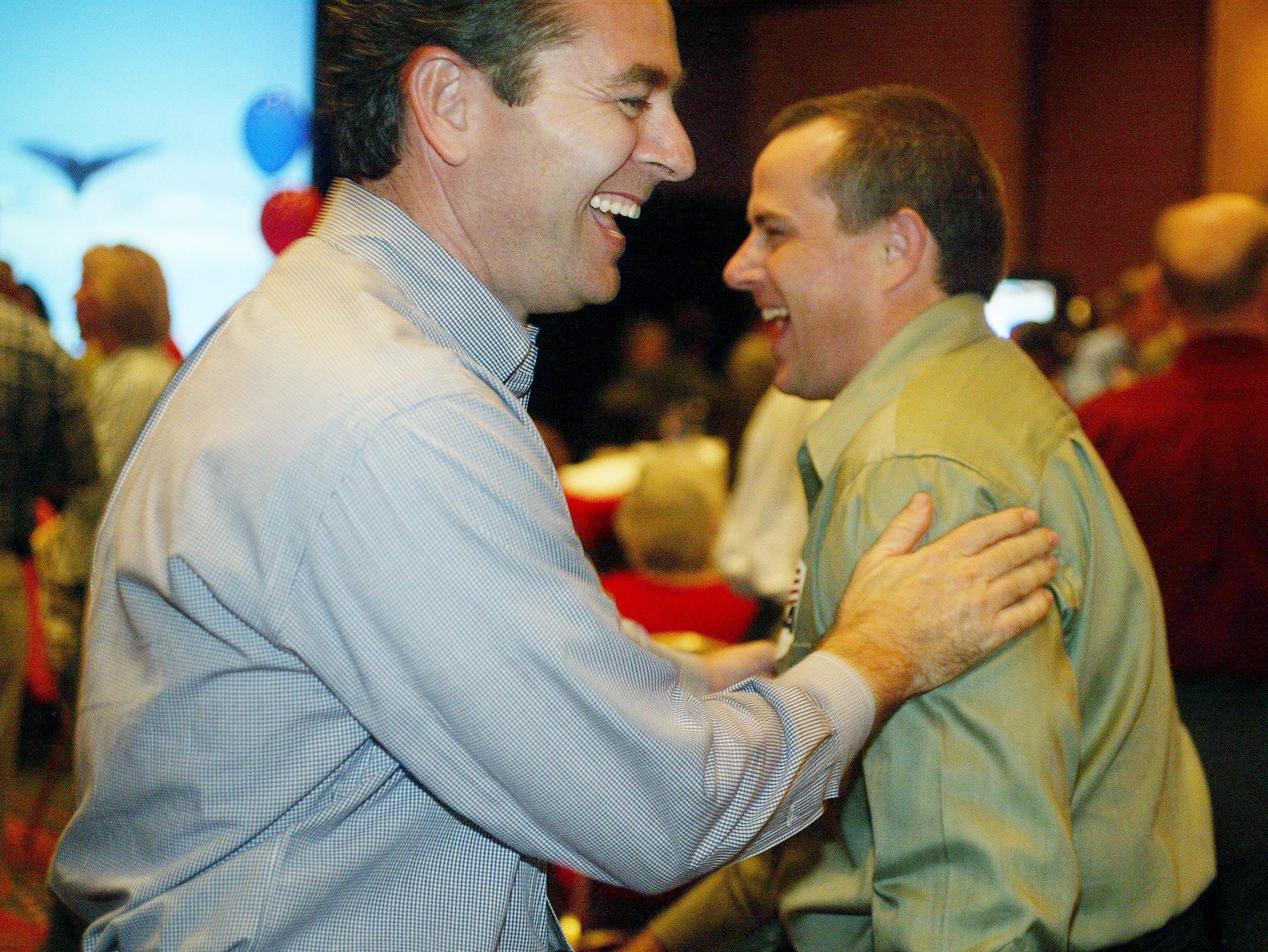 Glen Casada, left, greets supporters during the GOP victory party at the Embassy Suites in Cool Springs on Nov. 2, 2004.