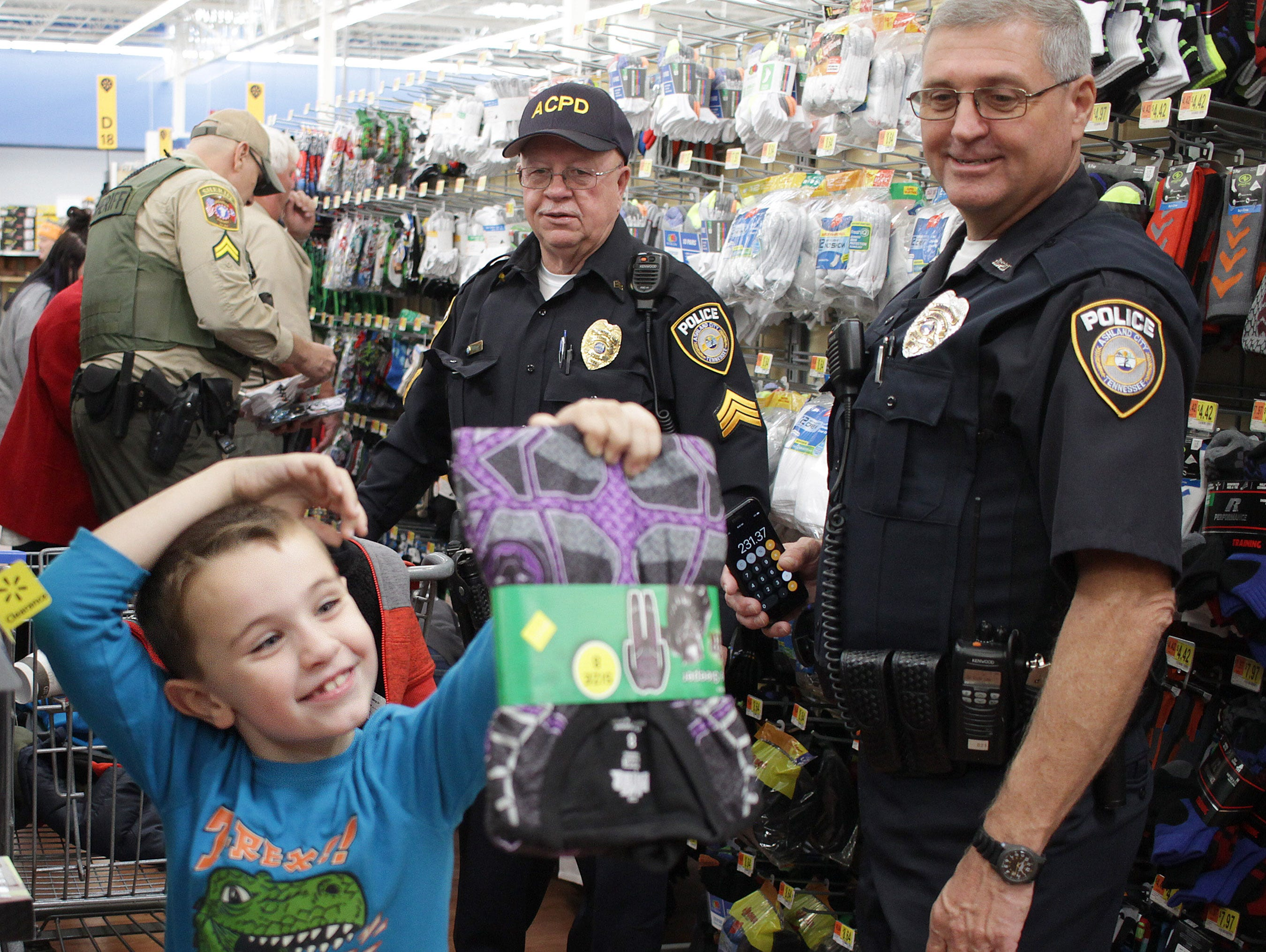 Johnathon Spann (6) finds some cool underwear he likes with Officer David Becker during Shop with a Cop in Askland City on Saturday, December 15, 2018.