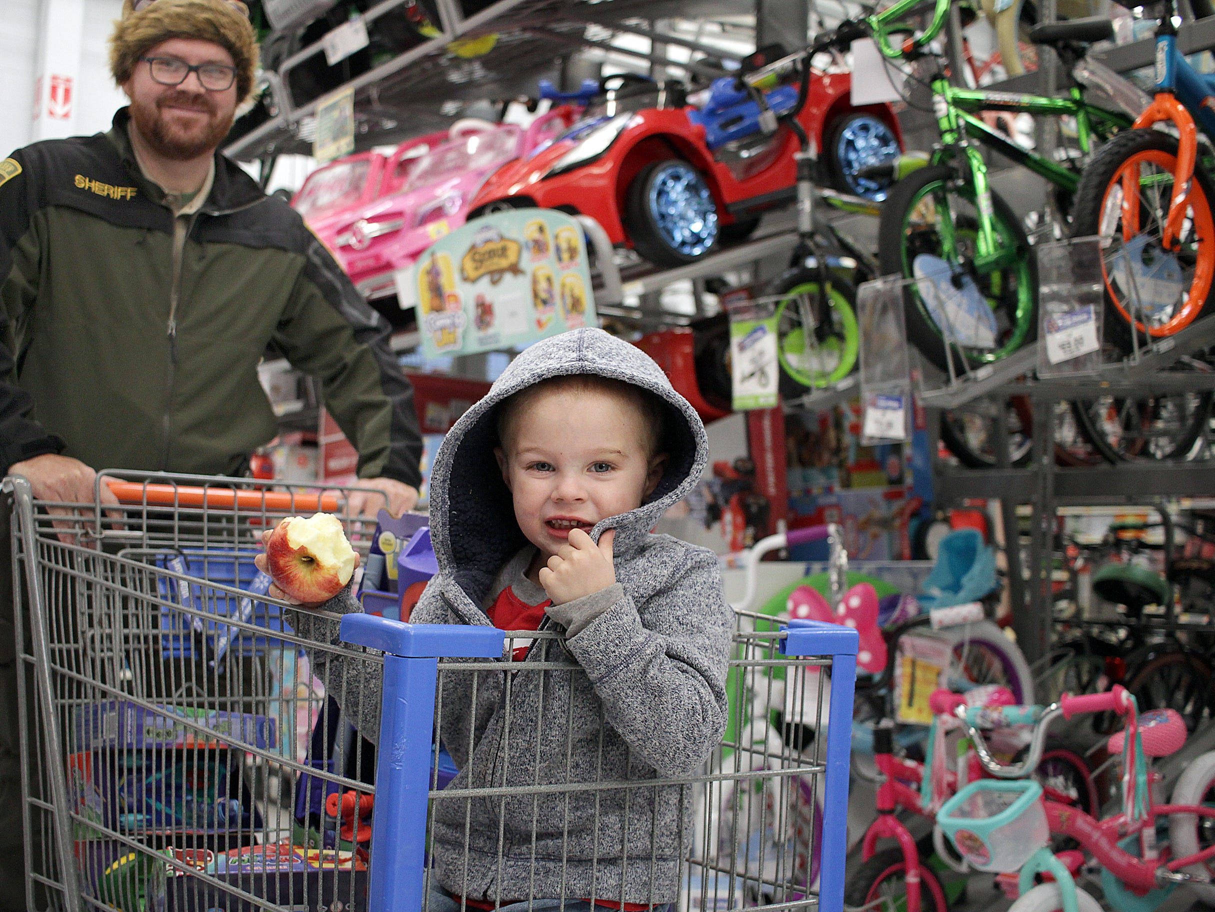 Officer Ryan Hawkins shops with Thomas during Shop with a Cop in Ashland City on Saturday, December 15, 2018.