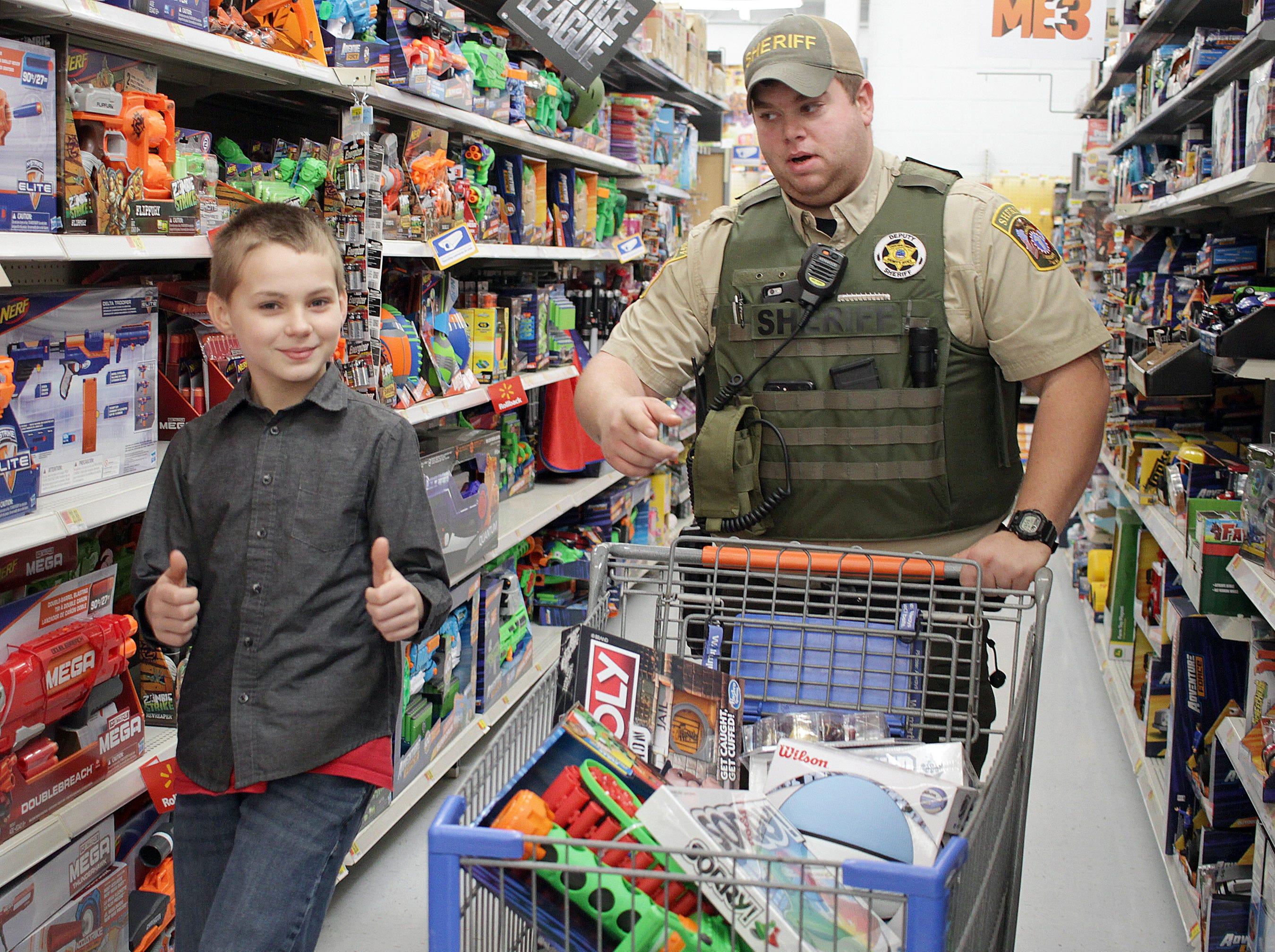 Asa Riggan shops with Deputy Josh Marriott at Shop with a Cop in Ashland City on Saturday, December 15, 2018.