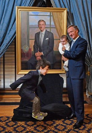 Gov. Bill Haslam holds his grandson Field Avery as his other grandson Kess Avery jumps in the photo at the governor's official portrait unveiling Monday Dec. 17, 2018, in Nashville, Tenn.