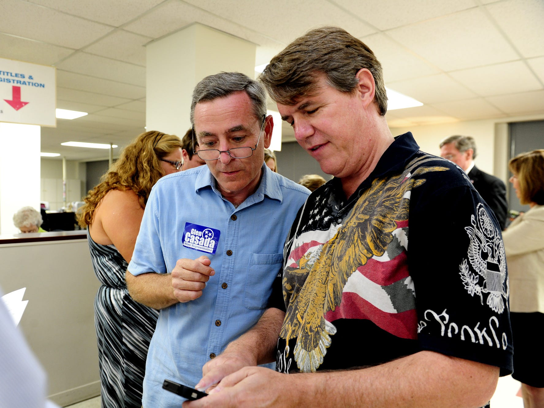 State Rep. Glen Casada, left, looks over early voting returns with Williamson County Commissioner Jeff Ford on Aug. 7, 2014. Casada, R-Franklin, held onto his District 63 seat for a seventh term.