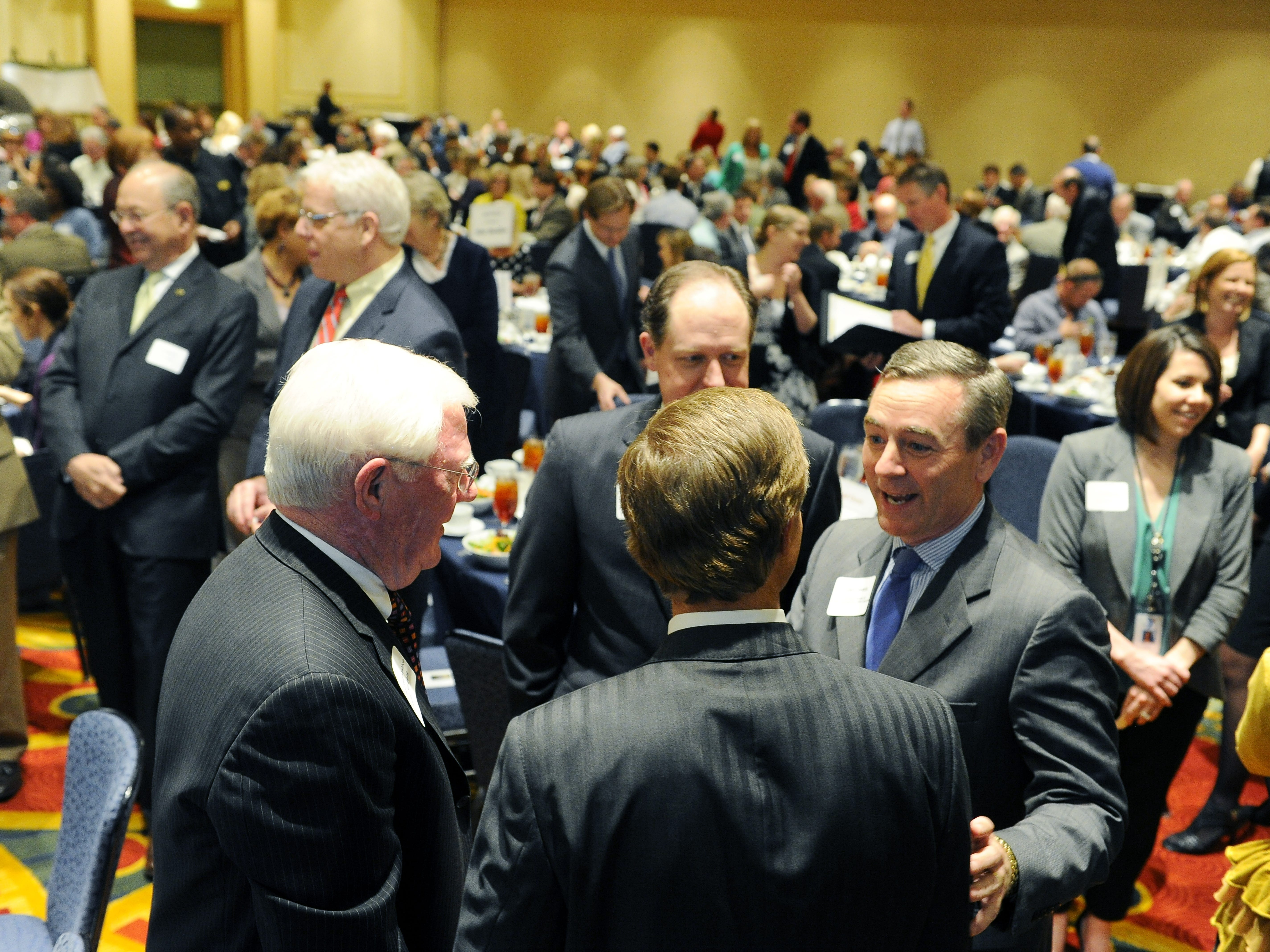 Gov. Bill Haslam, back to camera, talks with Rep. Charles Sargent, left, Rep. Jack Johnson, center, and Rep. Glen Casada during a Williamson County Chamber of Commerce meeting in Franklin on May 13, 2013.