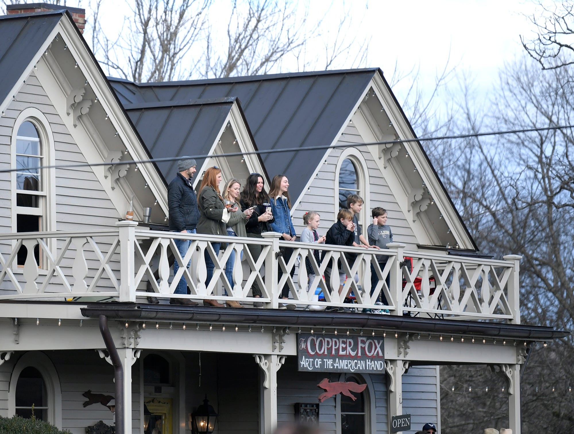 People watch the Leiper's Fork Christmas Parade from a balony on Saturday, Dec. 15, 2018.