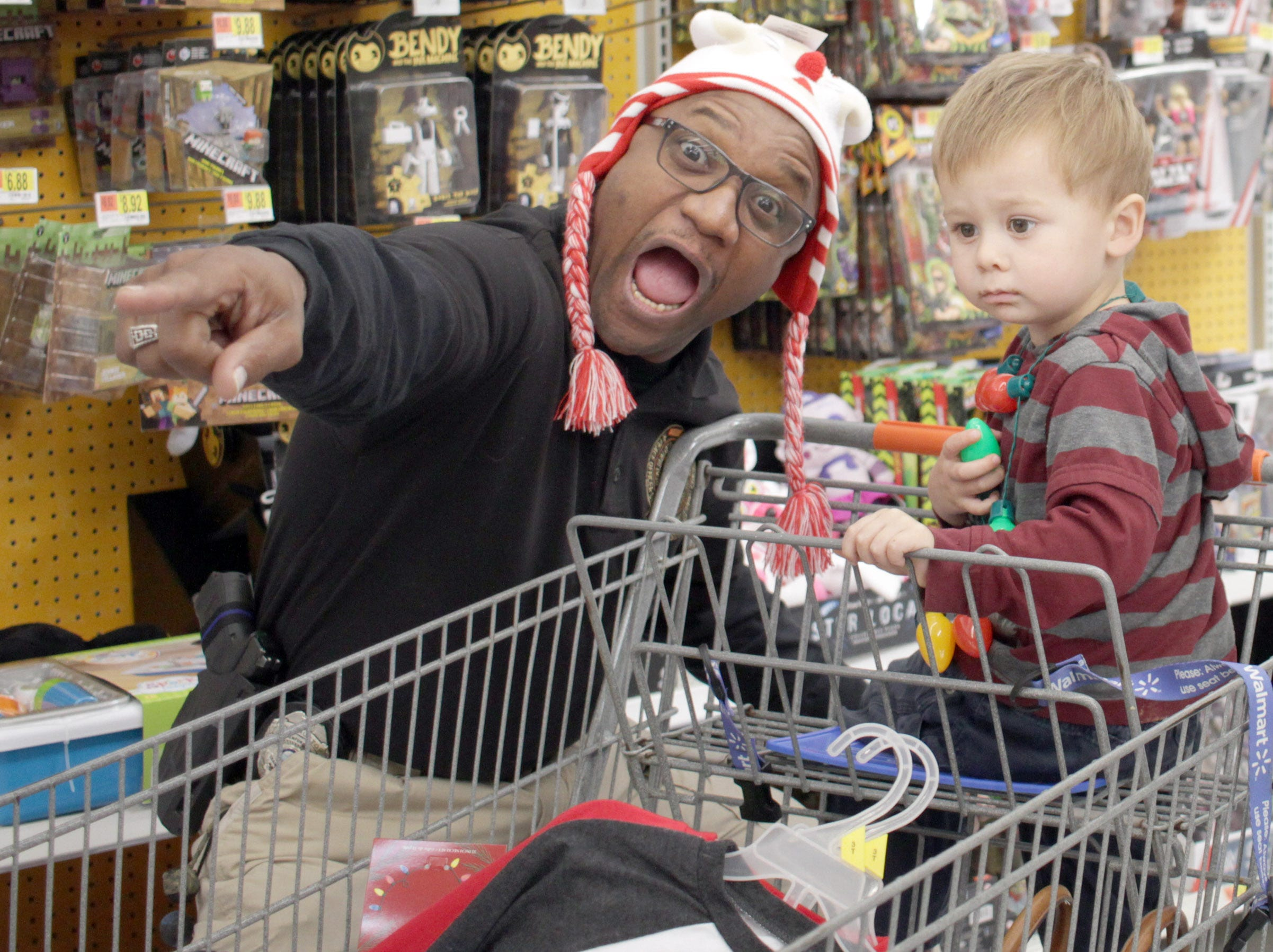 Officer Dexter Mines has some fun with Billy Reddiker  (2) during Shop with a cop in Ashland City on Saturday, December 15, 2018.