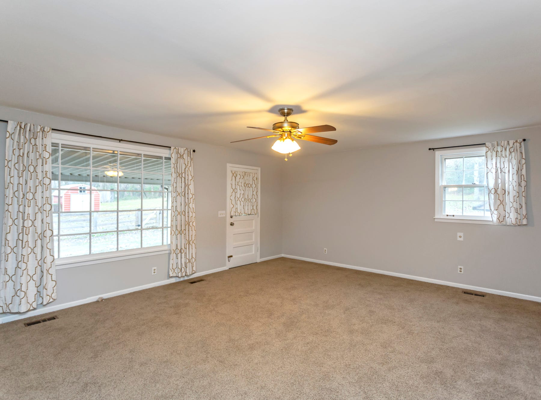 The master bedroom space in the home for sale at 3038 Wilson Pike is empty, which can make it hard for potential home buyers to see how it would look furnished.