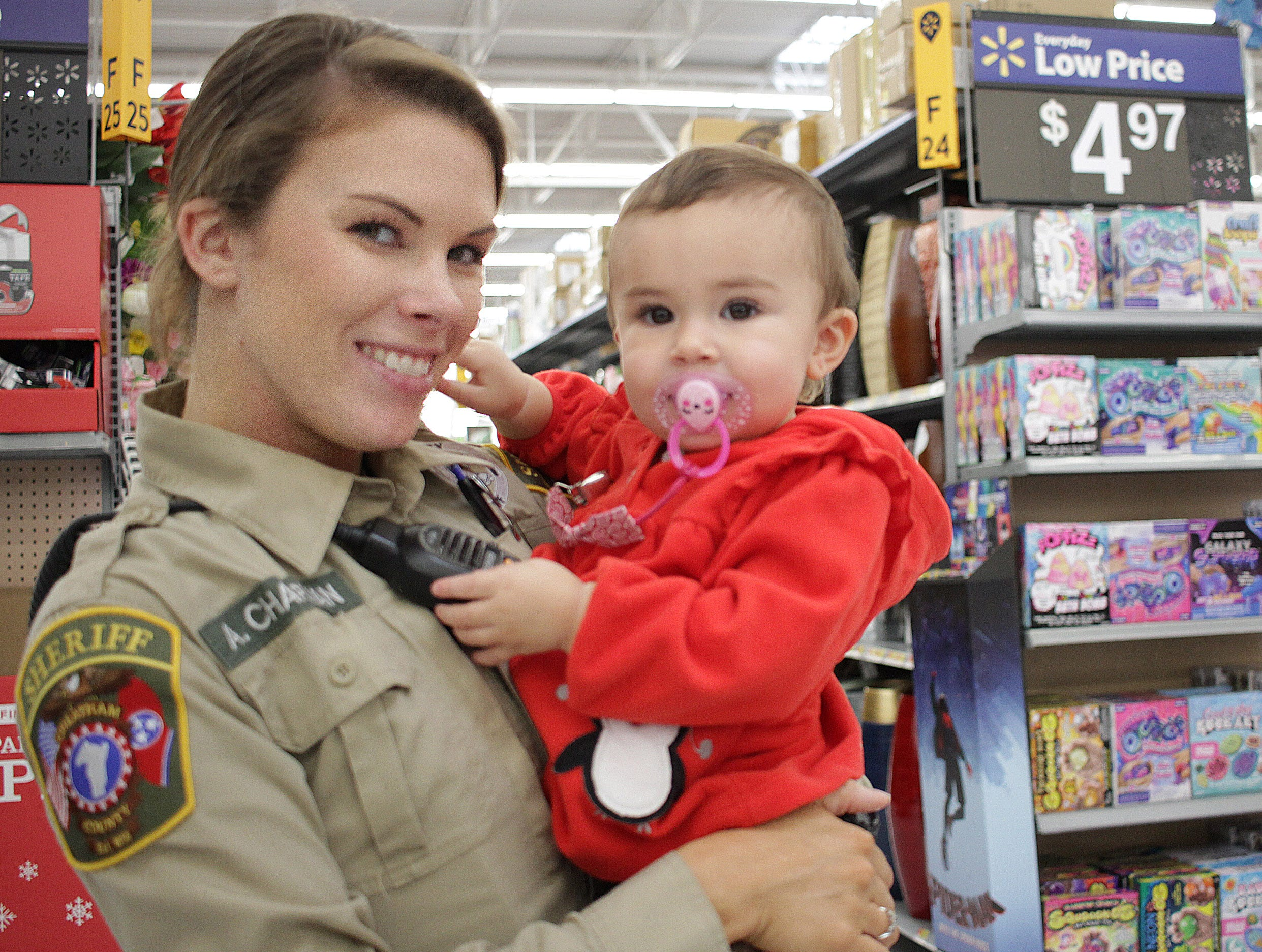 Deputy Ali Champman shops with her daughter Asher during Shop with a Cop in Ashland City on Saturday, December 15, 2018.