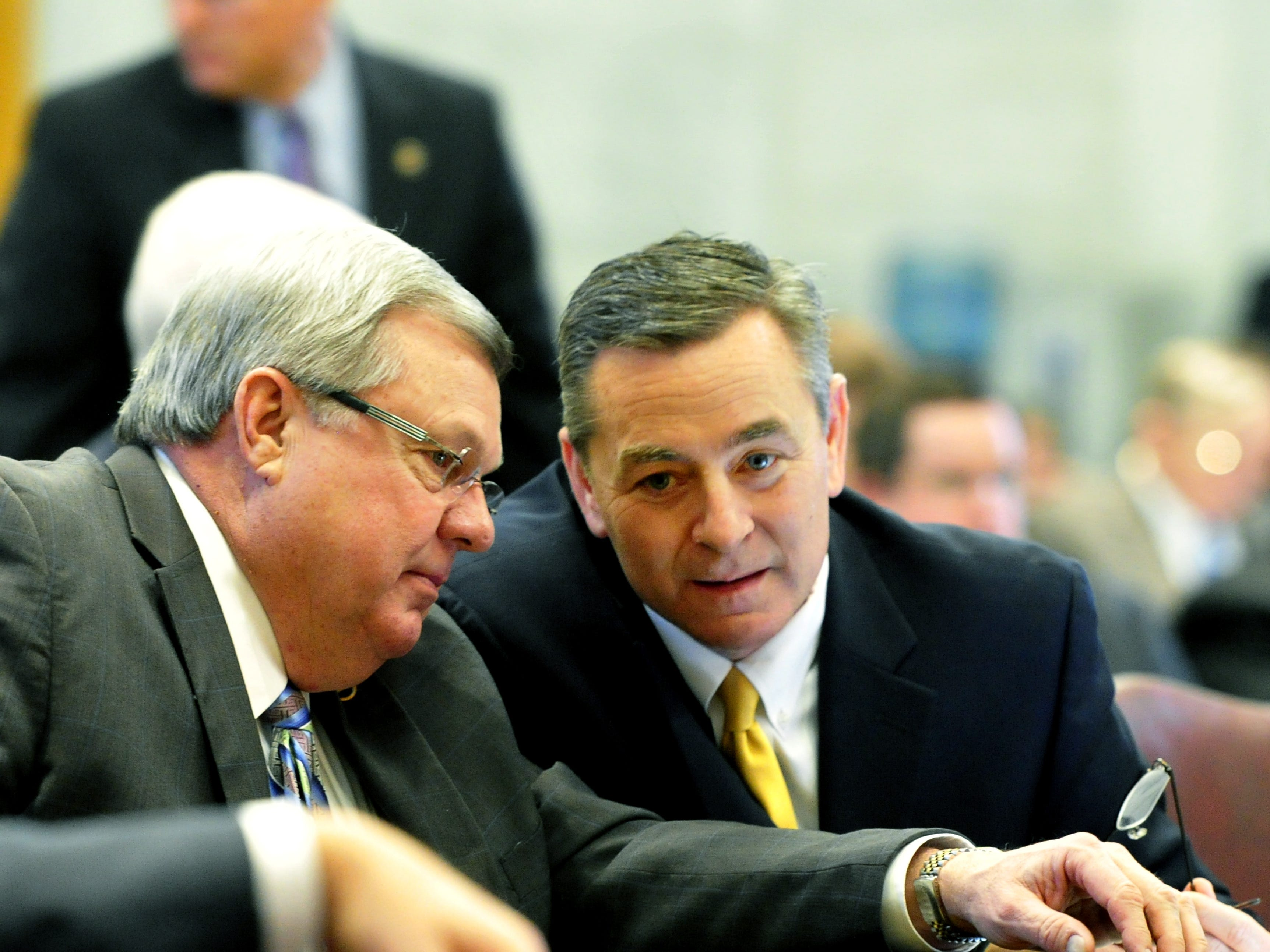 Rep. Curtis Johnson, left, and Rep. Glen Casada talk as the Tennessee House of Representatives approved legislation allowing grocery stores to sell wine Feb. 20, 2014.