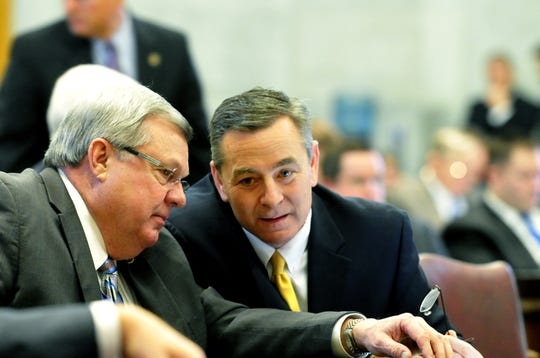 Rep. Curtis Johnson, left, and Rep. Glen Casada talk as the Tennessee House of Representatives approved legislation allowing grocery stores to sell wine on Feb. 20, 2014.