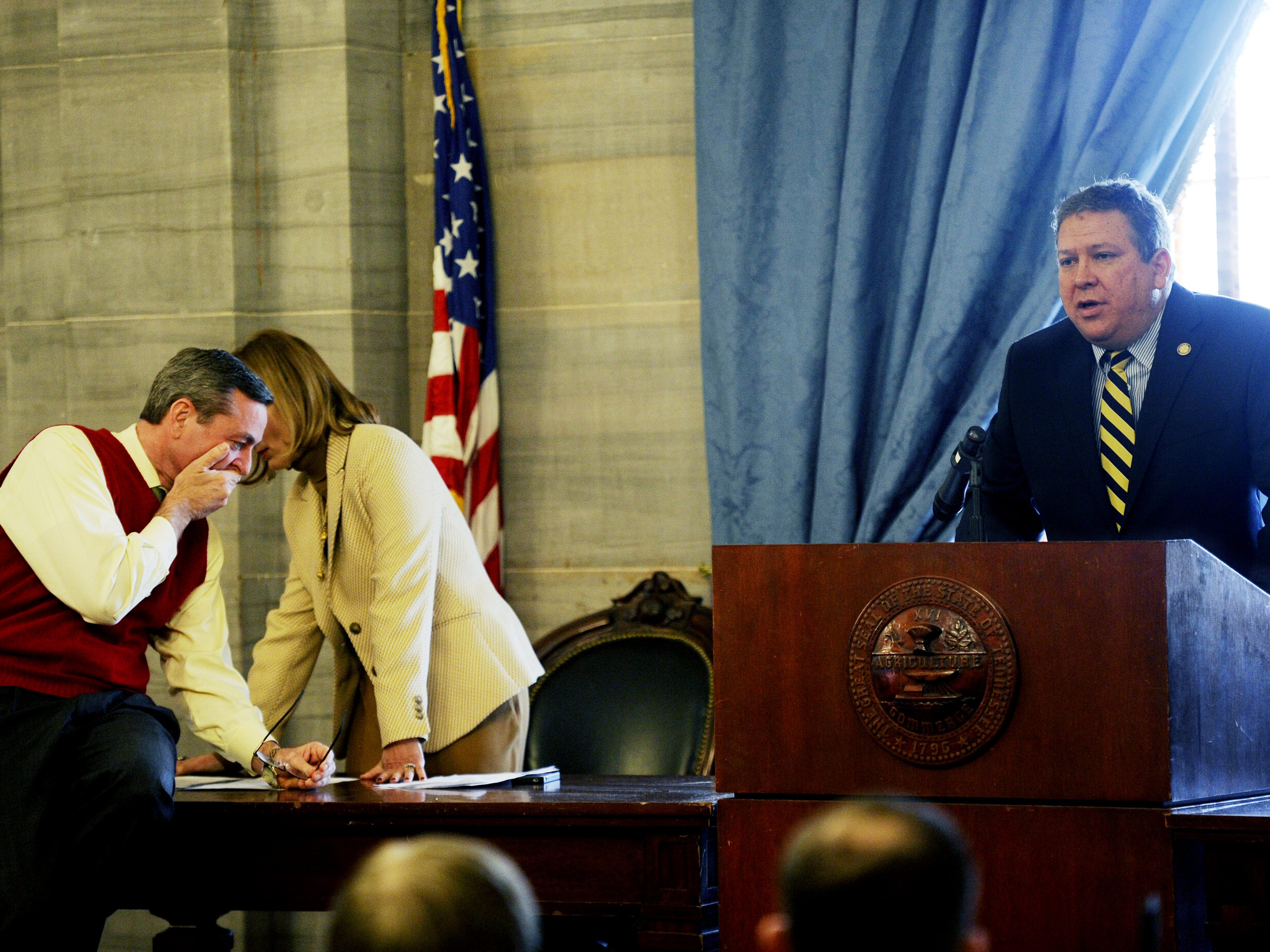 """Rep. Glen Casada, left, and House Speaker Beth Harwell talk while House Majority Leader Gerald McCormick speak during a meeting Feb. 28, 2013. Harwell told Republicans they should vote as they saw fit on the """"guns in trunks"""" bill. It passed 72-22."""